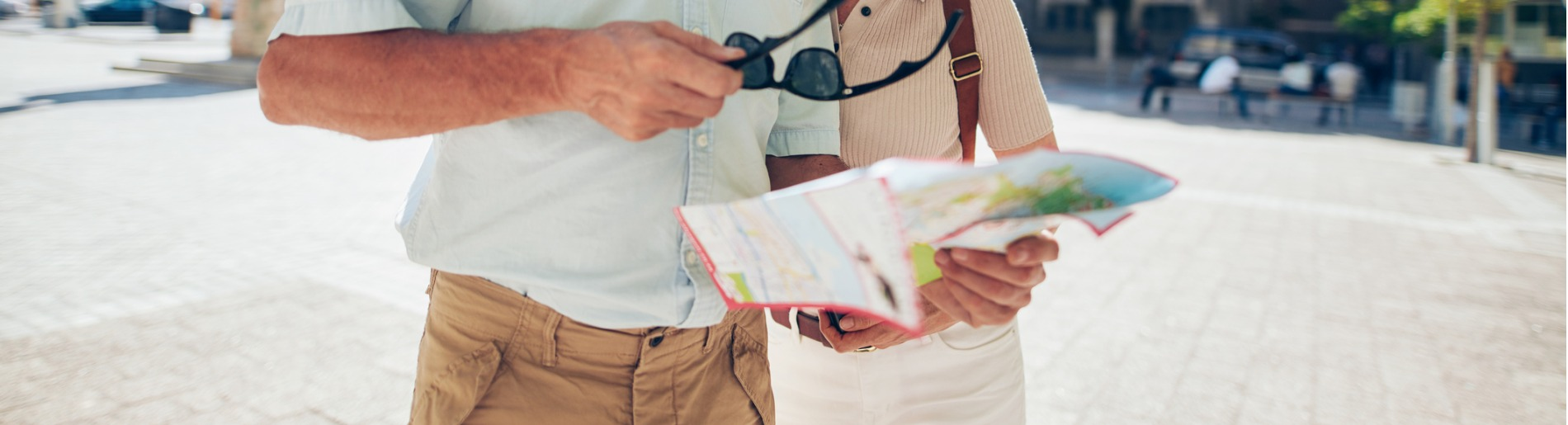 Tourist couple looking at map