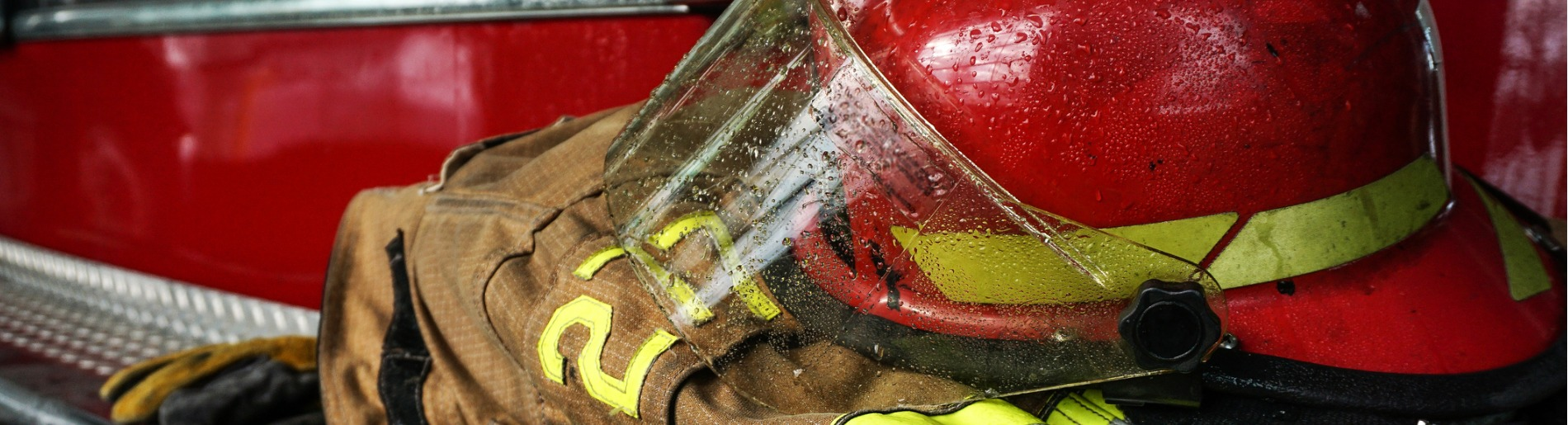 Firefighter's helmet and coat sitting on fire truck